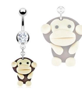Fræk navlepiercing med en lille abe.